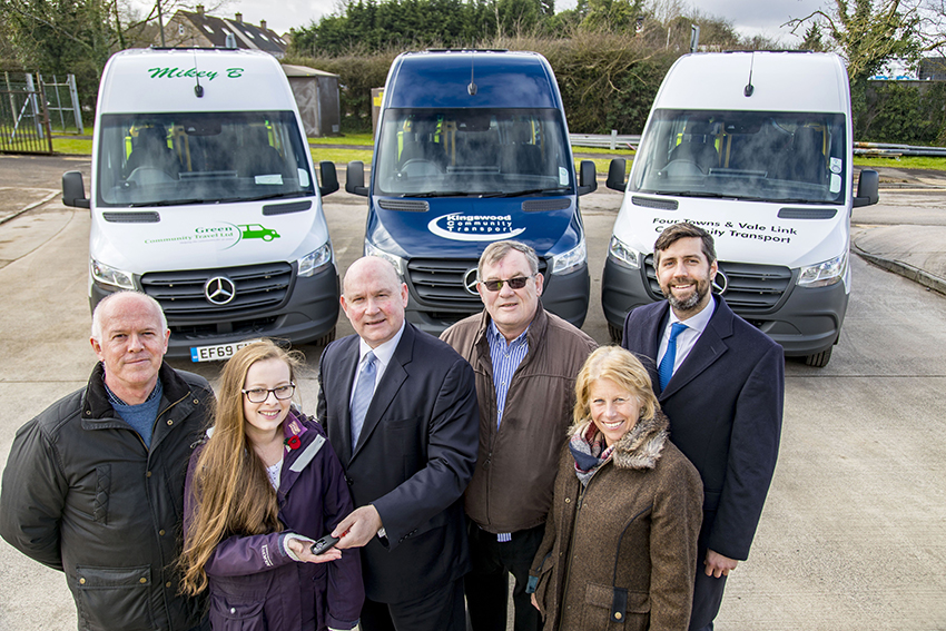 South Gloucestershire Council leader Toby Savage, right, and  West of England Mayor Tim Bowles, centre, with community transport operators and their new vehicles