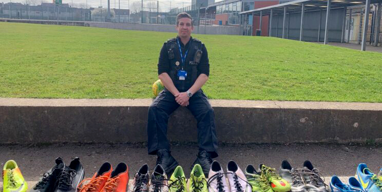 Ryan Day with some of the boots that have already been donated