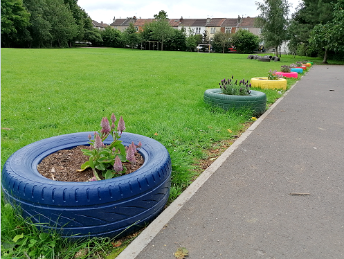 Tyres have been painted and turned into planters