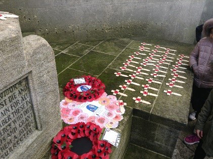 Students laid a poppy wreath on the war memorial at Kingswood Trinity Church