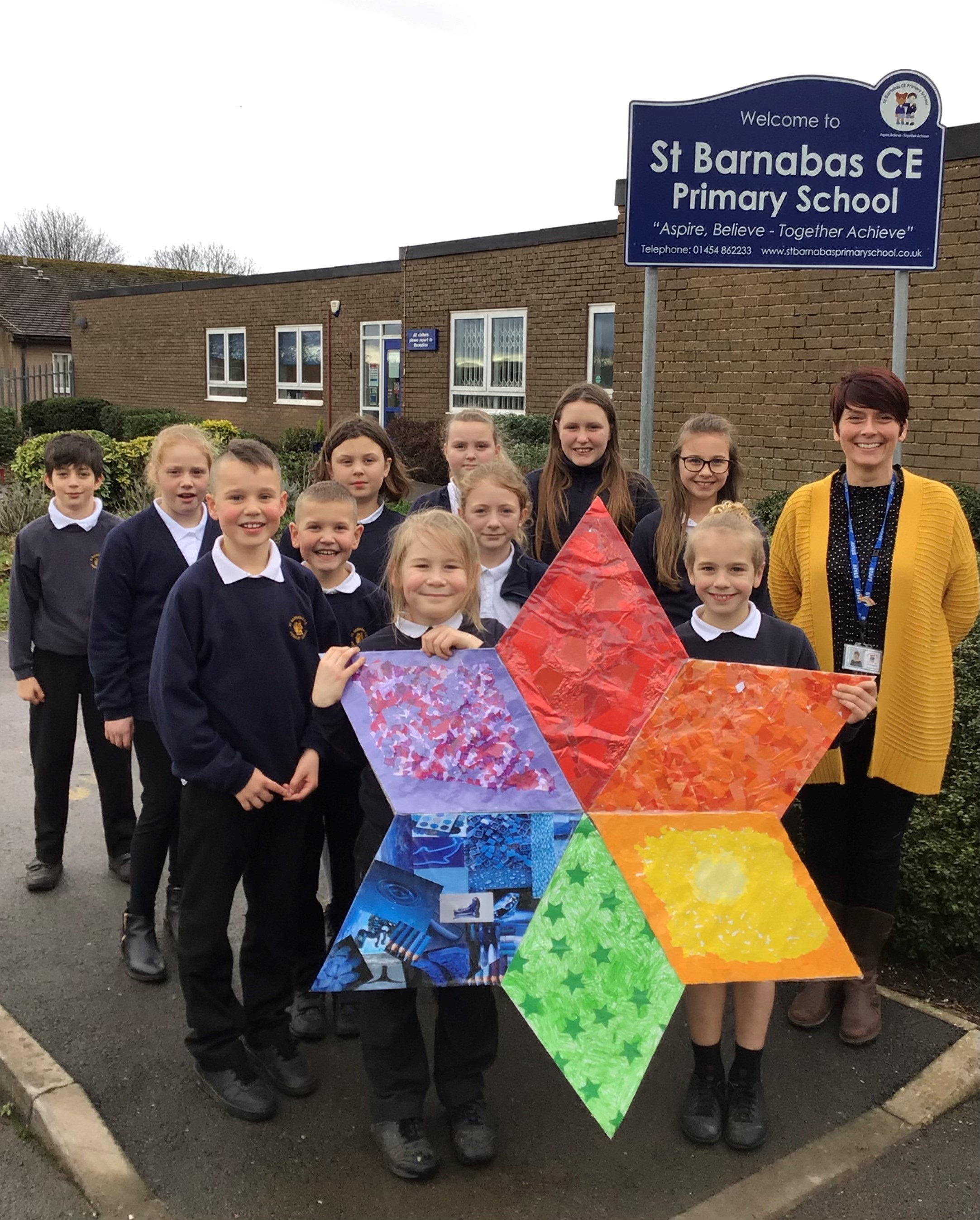Some pupils from St Barnabas Primary with a rainbow star