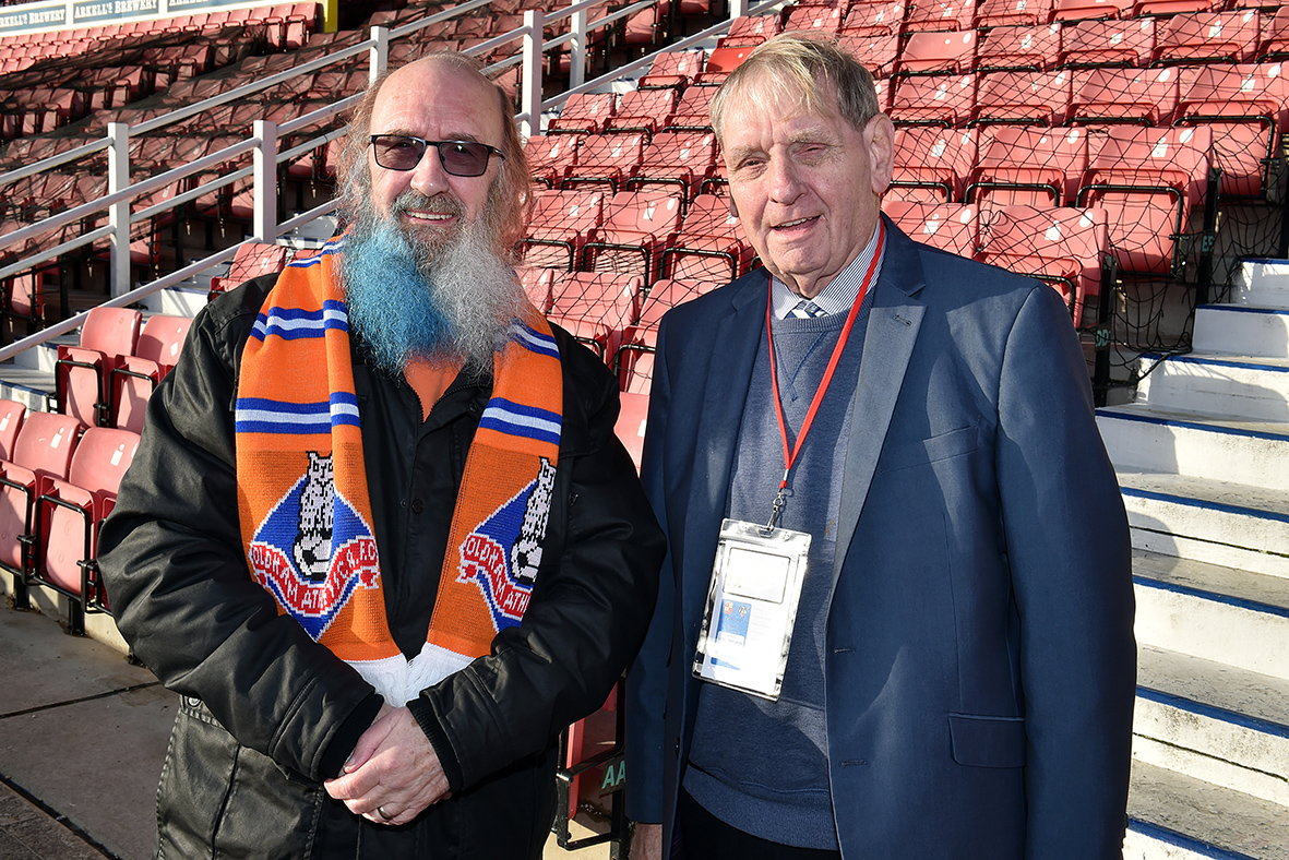 Pete Davis and his colour beard and hair in aid of the Multiple Sclerosis Trust, with Oldham Athletic's Roy Butterworth