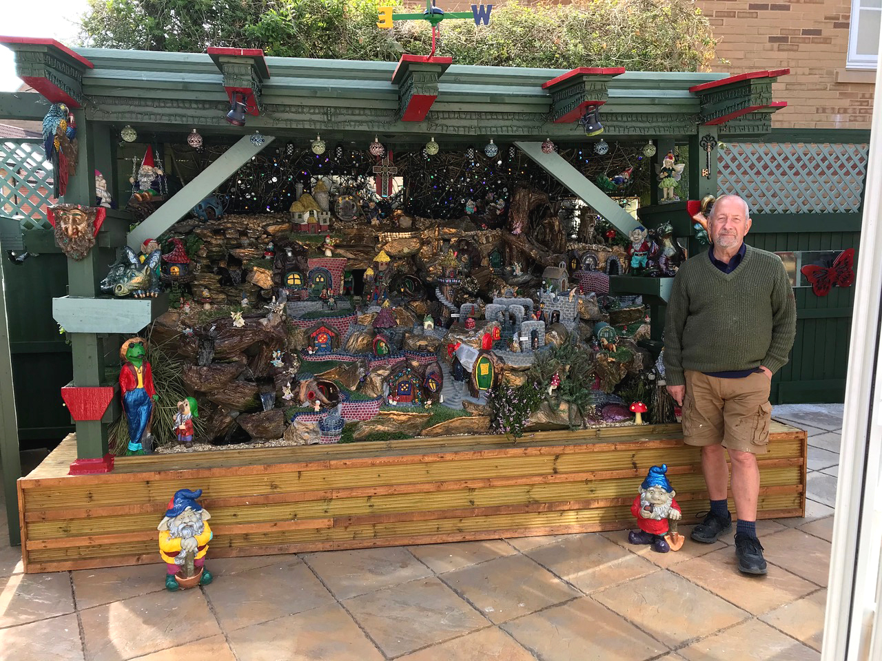 Ron Smith-Bishtopn with one of the exhibits in his fairy garden
